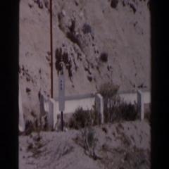 1958: man posing alongside highway parked car LAS VEGAS Stock Footage