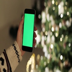Close-up of female hands touching of smartphone. Green screen Chroma Key. Close Stock Footage
