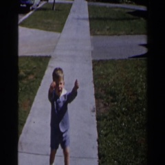 1958: a little lad walking along the concrete pavement in the meadow LAS VEGAS Stock Footage
