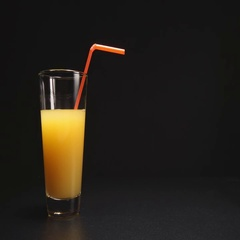 Orange juice disappear from a glass with a tube (stop motion) Stock Footage