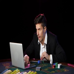 Player plays poker online bets and wins. Close up Stock Footage