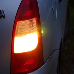 Car silver blinker is blinking in the evening standing still Stock Footage
