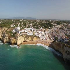 Aerial. Flying over the beach and the tourist village of Carvoeiro. Portugal. Stock Footage