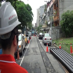 A worker is controlling a work on the road. Renovation of water pipes. Stock Footage