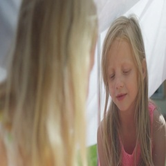 4K 2 little girls having a tea party under a makeshift tent in the garden Stock Footage