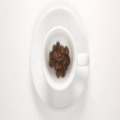 TOP VIEW: Coffee beans in a white cup (stop motion) Stock Footage