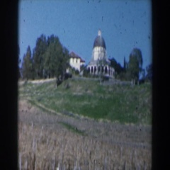 1960: view of a fancy building sitting in a field. ISRAEL Stock Footage
