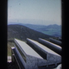 1960: a view of vistas and mountains from vehicle, with houses and neighborhoods Stock Footage