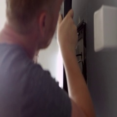 Two Men Fitting Flat Screen Television To Wall Shot On R3D Stock Footage