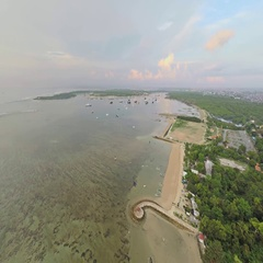 Aerial shot of sunrise in Sanur beach, camera facing Serangan Stock Footage