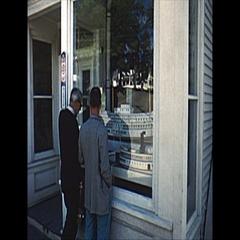 Vintage 16mm film, 1959, men looking at ship models City of Bangor Stock Footage