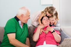 Grandparents And Grandchildren Playing Together Stock Photos
