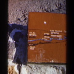 1960: wooden box painted in brown with some engravings on it on beach. ISRAEL Stock Footage