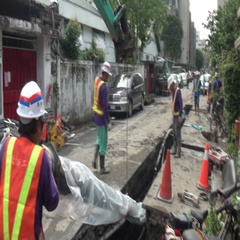 Operators are introducing in a trench a new water pipe. Water leak. Stock Footage