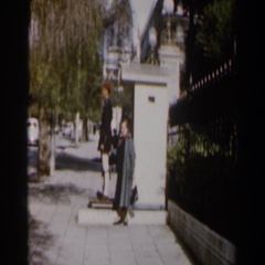1960: two people waiting for a bus at daytime ISRAEL Stock Footage
