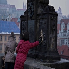 Monuments Prague. Touch the monument to happiness. Stock Footage
