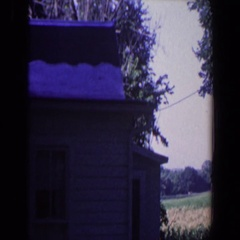 1959: standing outside a country house in the winter and examining the roofing. Stock Footage