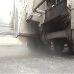 A concrete saw in operation used by an operator to cut the asphalt. Stock Footage