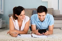 Couple Calculating Bills Together At Home Stock Photos