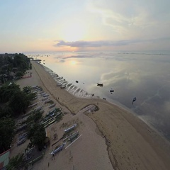 Aerial shot of sunrise in Sanur beach, camera going along the coast Stock Footage