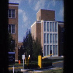 1960: view of city buildings and their fancy cars parked below. BALTIMORE Stock Footage