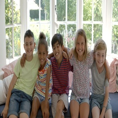 Group Of Multi-Cultural Children On Window Seat Together Stock Footage