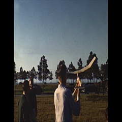 Vintage 16mm film, 1952, RC Airplane hand launched in field Stock Footage