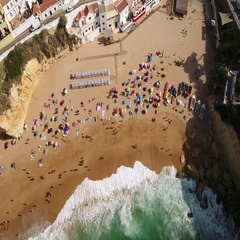 Aerial. Shooting Carvoeiro beach village sky. Portugal Stock Footage