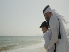 Arab family having fun at the beach. Stock Footage