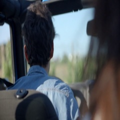 Young man driving a car, rear passenger point of view Stock Footage