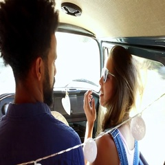 Mixed race couple on sitting in the front of camper van Stock Footage