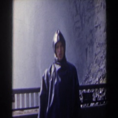 1963: person in raincoat near waterfall NIAGARA FALLS Stock Footage