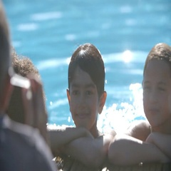 Photographer Taking Picture Of Children In Swimming Pool Stock Footage
