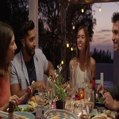 Friends laughing at a dinner party on a roof terrace, Ibiza, shot on R3D Stock Footage