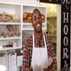 Owner behind the counter of sandwich bar crosses arms, shot on R3D Stock Footage