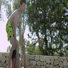 Son Jumping From Father's Shoulders In Outdoor Pool Stock Footage