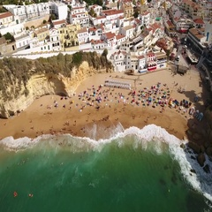 Aerial. Shooting from the sky, beach and the of tourists village of Carvoeiro. Stock Footage