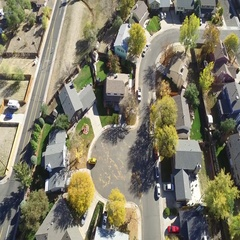 Fly over of a typical suburban neighborhood COLORADO Stock Footage