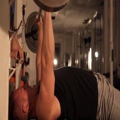Muscular bodybuilder guy doing exercises. raises the bar. Stock Footage