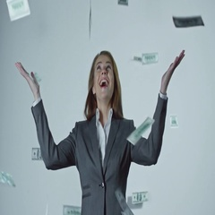 Dollars Falling on Ecstatic Businesswoman Stock Footage