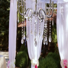 Beautiful crystal chandelier with a light cloth on the wedding ceremony. Stock Footage