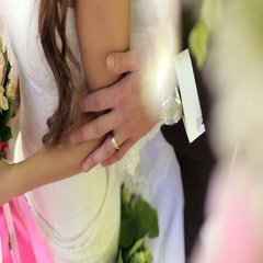 Happy bride and groom.  The groom pats the bride on the arm. Wedding. Stock Footage