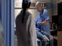 Medical team enters exam room to care for casualty patient 4K Stock Footage
