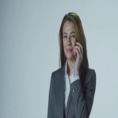 Money Falling on Businesswoman Talking on Mobile Phone Stock Footage