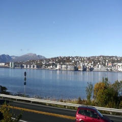 Pan view on a road in front of the city of Tromso, in north Norway Stock Footage