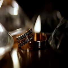 Two rings on a black iridescent background. Wedding rings. Golden rings close-up Stock Footage