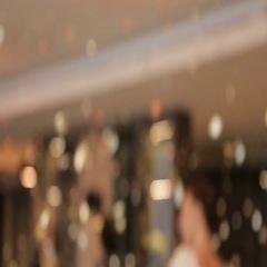 Beautiful woman among golden confetti. Sexy woman dancing among confetti. Stock Footage