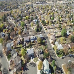 An aerial view of a major road running through an urban residential area Stock Footage