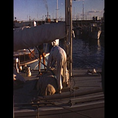Vintage 16mm film, 1962 Americas Cup, yacht Gretel stowing sails Stock Footage