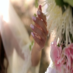 Beautiful bride's hand stroking the flowers. Crystals in the wedding decor. Stock Footage
